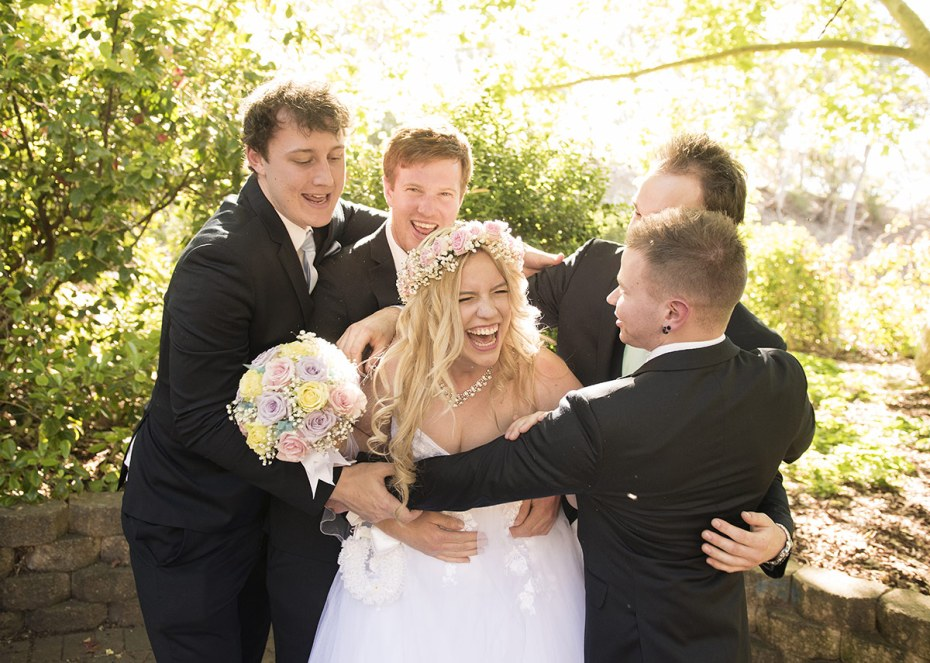 Bride and groomsmen having fun