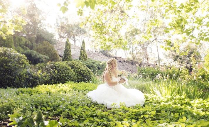 Bride sitting in sunlight