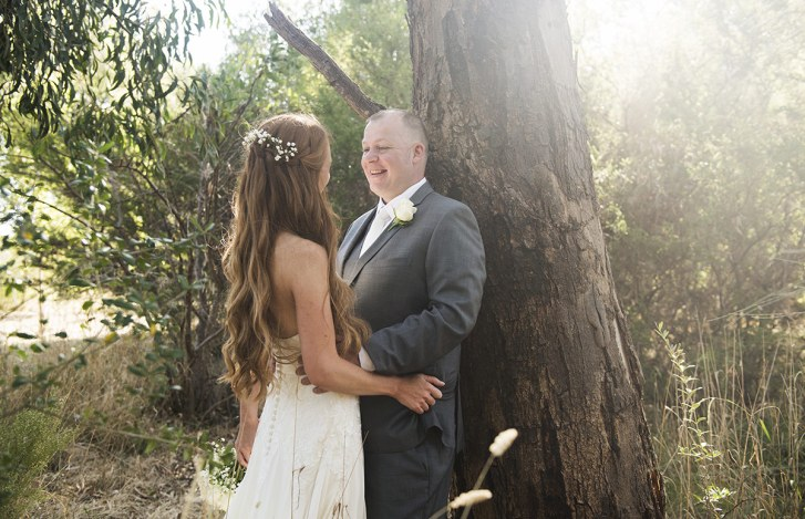 Bride and groom amongst the bush