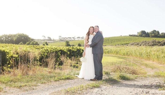 Bride and groom looking over McLaren Vale