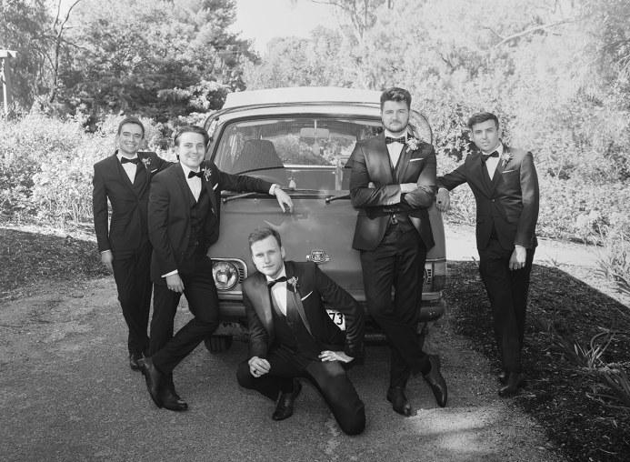 Groomsmen in front of Bus