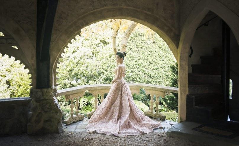 Bride framed in the castle fixtures