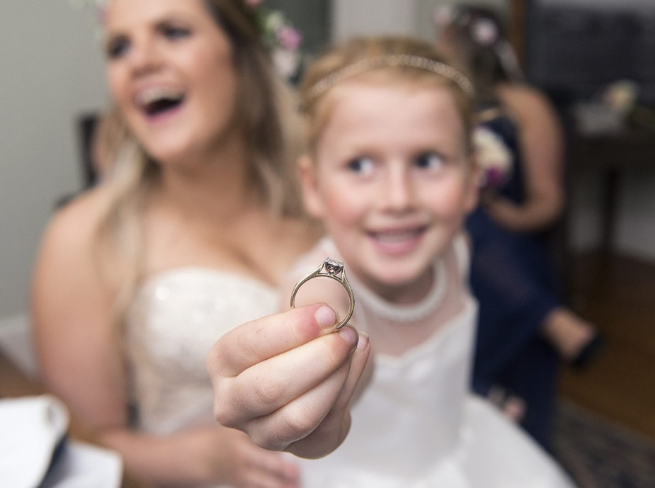 Flowergirl holding engagement ring