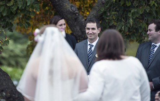 Groom seeing bride walking down aisle
