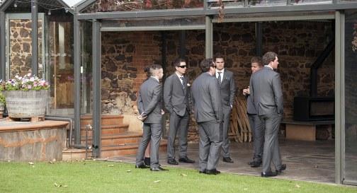 Groomsmen standing around
