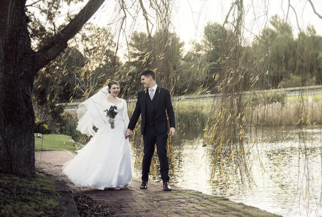 Brie and Groom walking at St Francis Winery