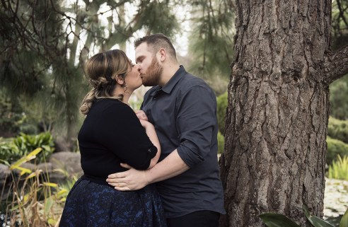 Kissing next to a tree