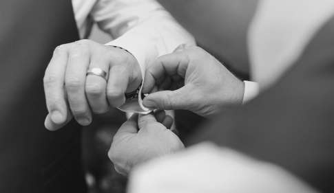 Putting on cufflinks