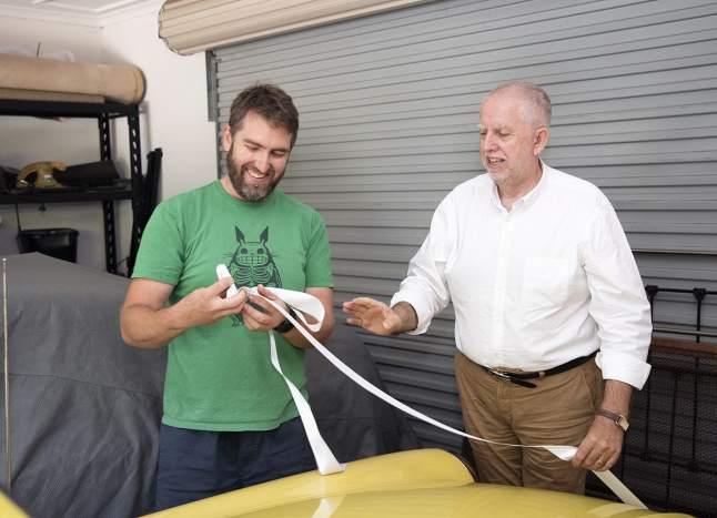 Putting ribbon on car