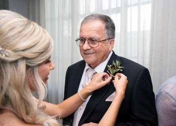 Putting flower on Dad