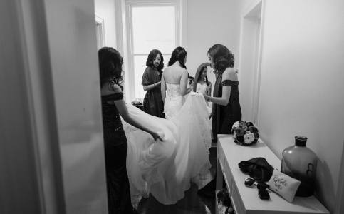Bridesmaids helping