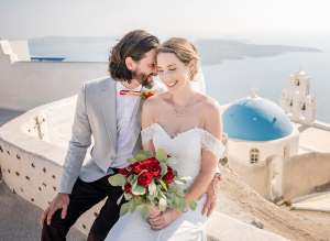 Bride and groom in front of blue domed church