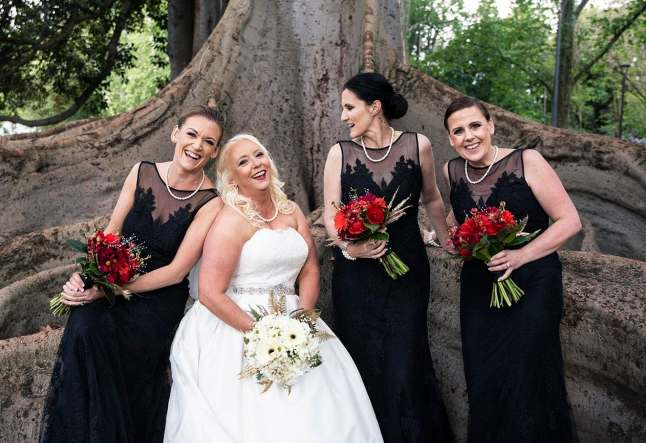Bride and bridesmaids in botanic Park tree