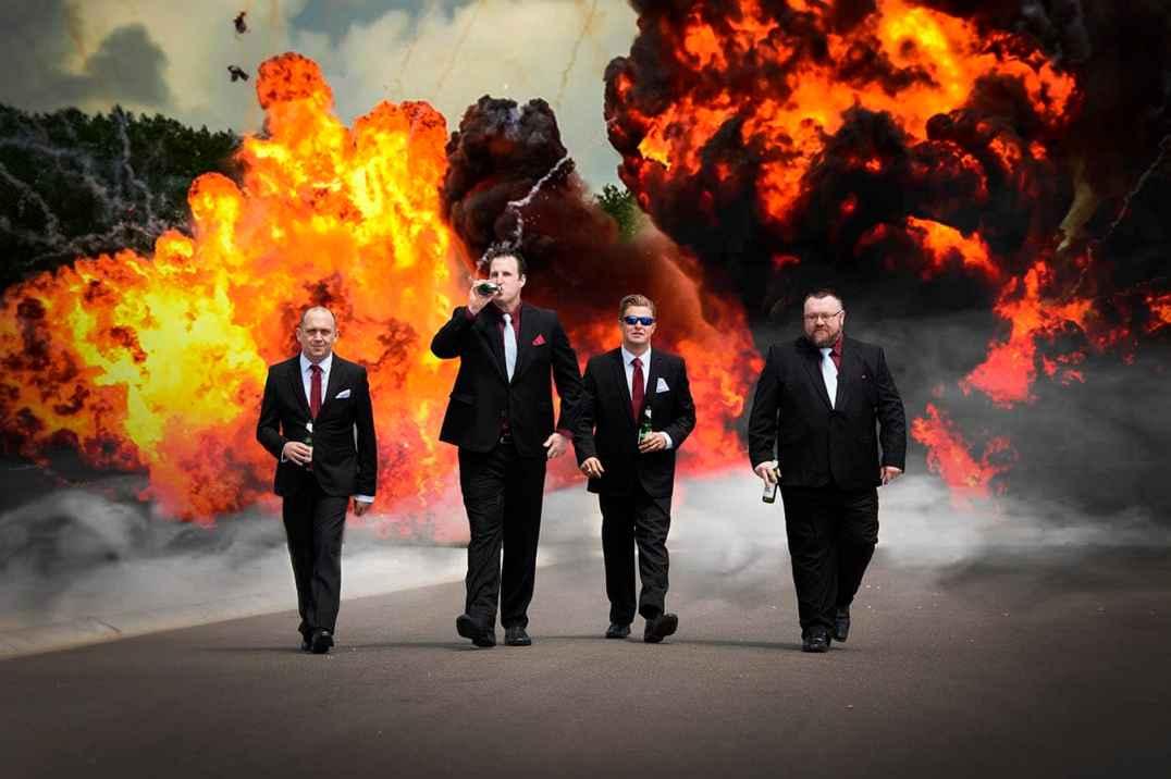 Groomsmen walking away from explosion