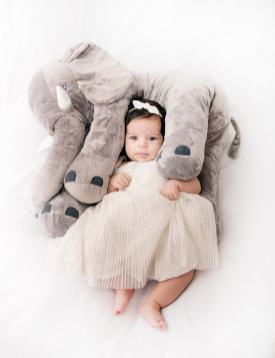 Baby with fluffy elephant
