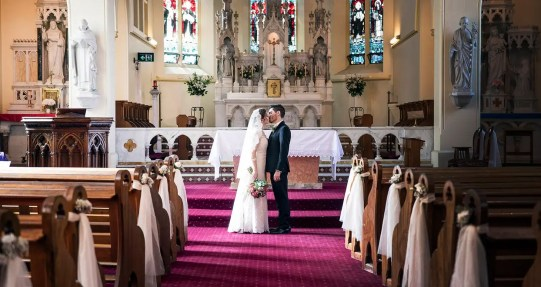 bridal couple kissing in St Laurences church