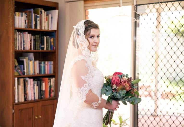 Bride standing with bouquet
