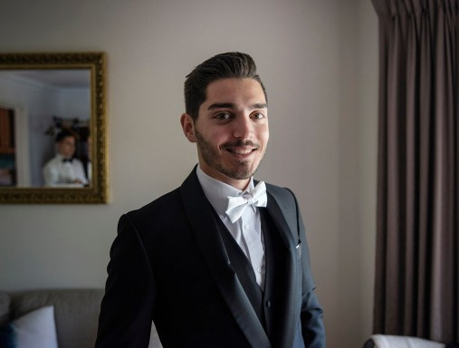 smiles on the groom