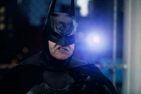 Blue light behind Batman