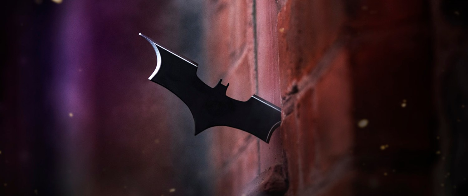 Batman cosplay batarang in wall
