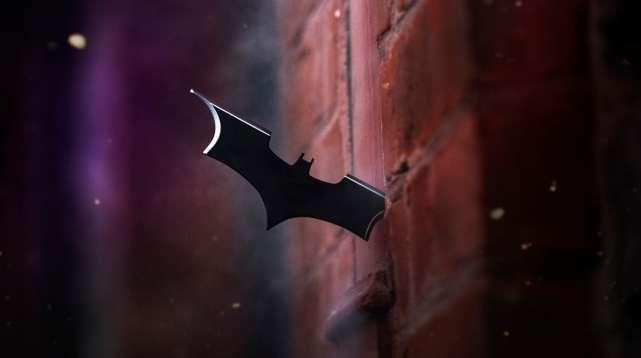 Batman cosplay batarang in wall