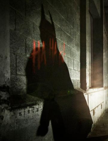 Batman shadow on joker grafitti