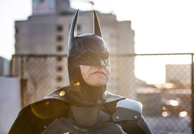 Batman standing in the sun