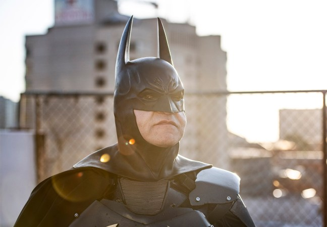 Batman standing in the sun