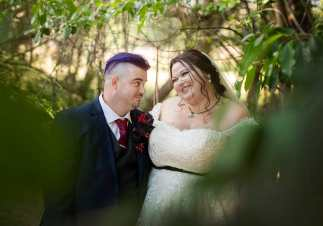 bride and groom amongst foliage