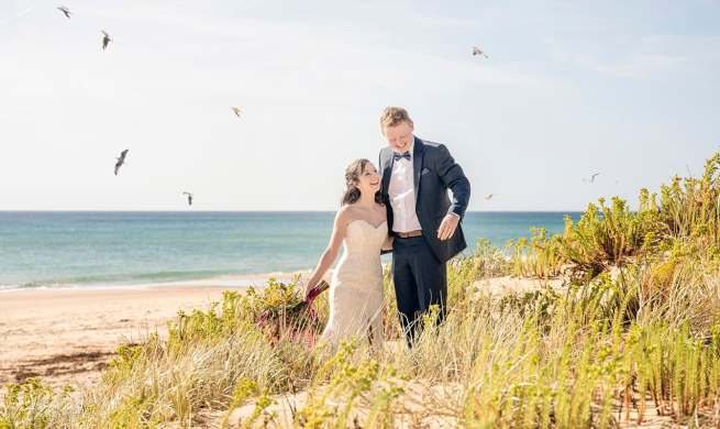 Bride and groom amongst the sanddunes