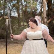 Bride holding a wedding sword