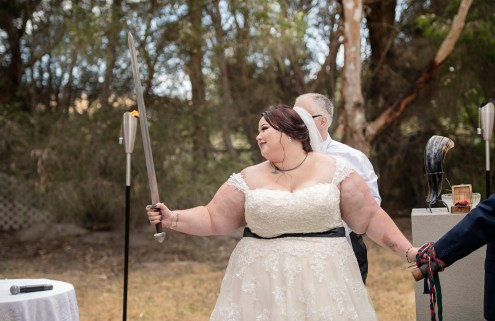 Bride holding a wedding sword