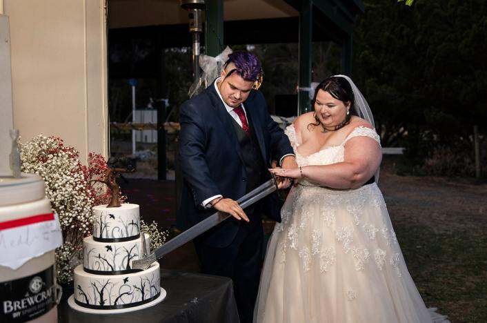 Cutting the cake with a sword
