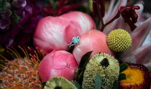 Engagement ring amongst bouquet