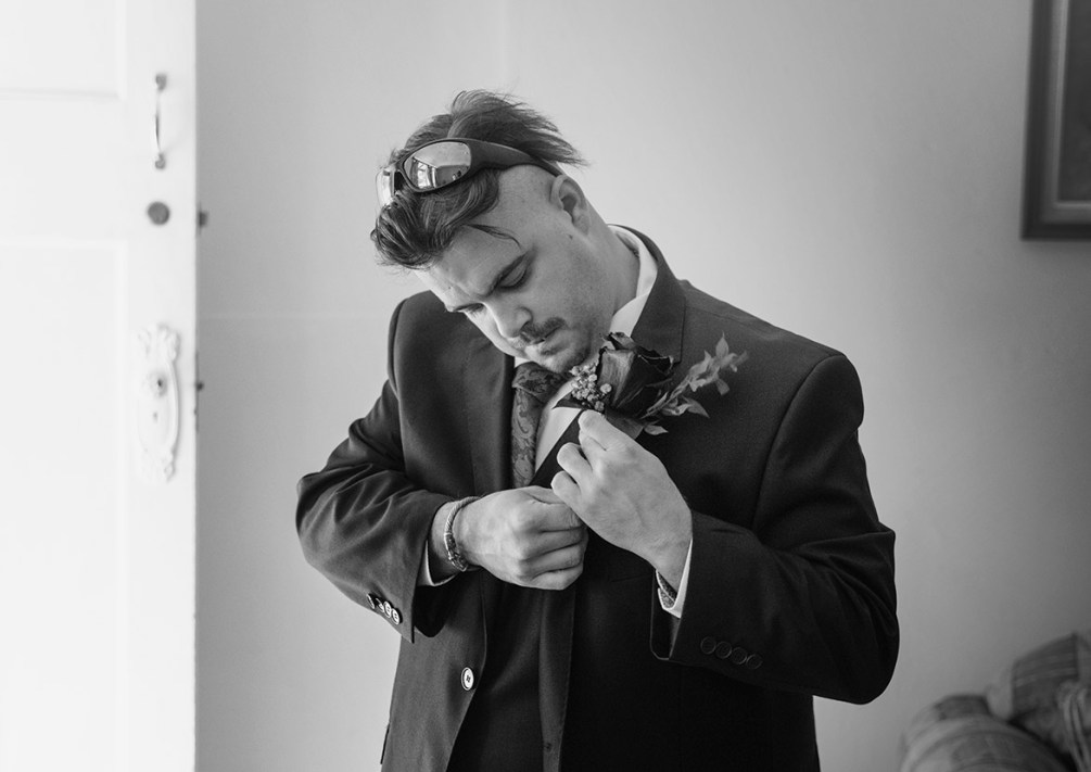 Groom getting ready near door