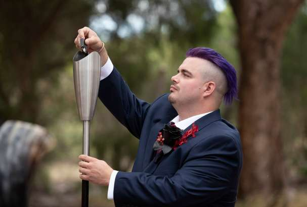 Groom Lighting the flame during the Asatru wedding ceremony