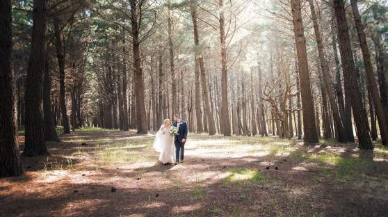 Bride and groom walking about Burbrook forest
