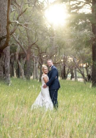 Sun shining on bride and groom