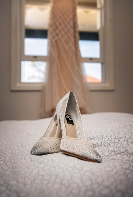 Wedding shoes on bed