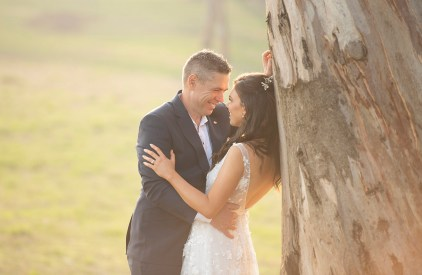Bride and groom against a gum tree