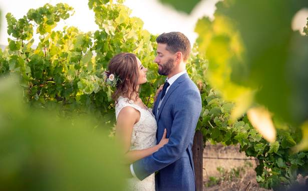 Bride and groom throught the vineyards