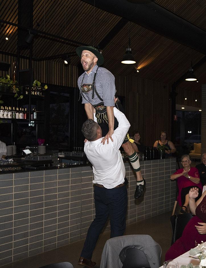 Groom lifting the German dancer