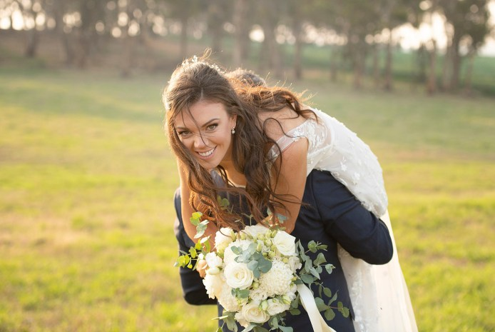 Laughing bride as she's carried