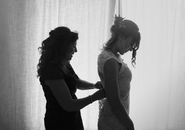 Mum helping bride get ready