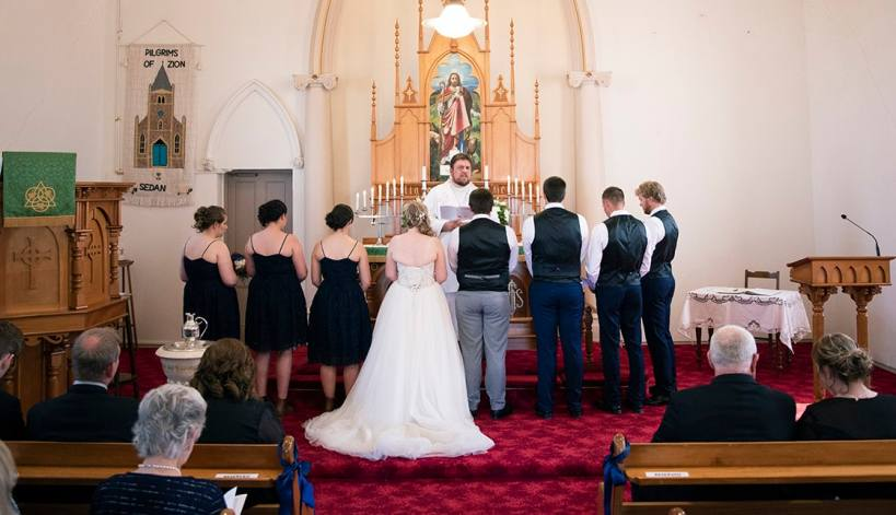 Bridal party at the front of church