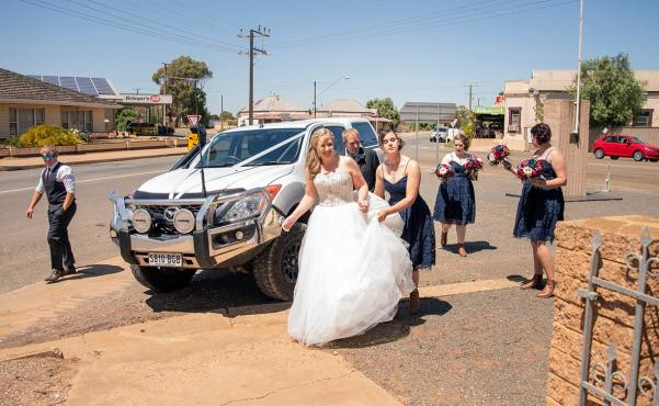 Bride arriving in front of church