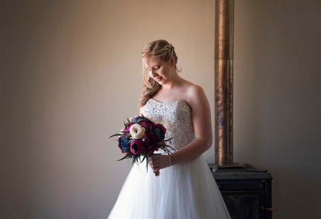 bride playing with bouquet