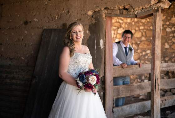 Groom looking at bride in ruin