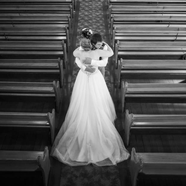 Hugging in the church's aisle
