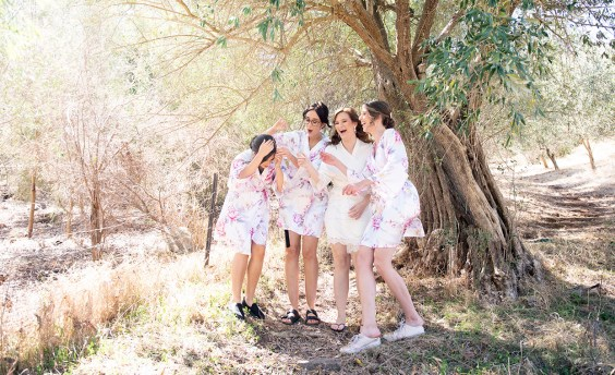 Bridal party in kimonos under tree